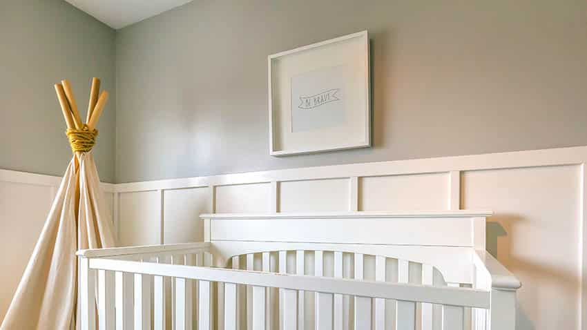 Baby nursery with board and batten wall paneling