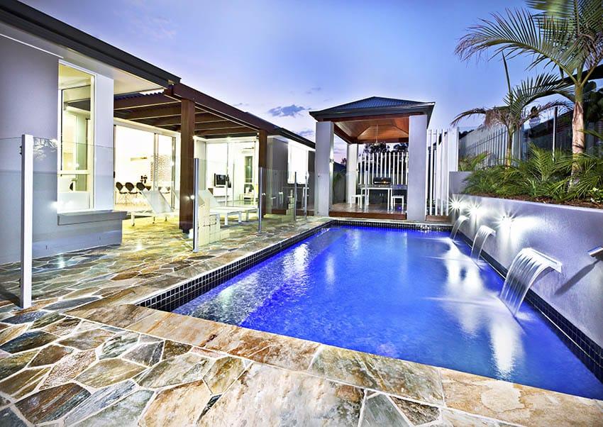 Backyard swimming pool with flagstone decking