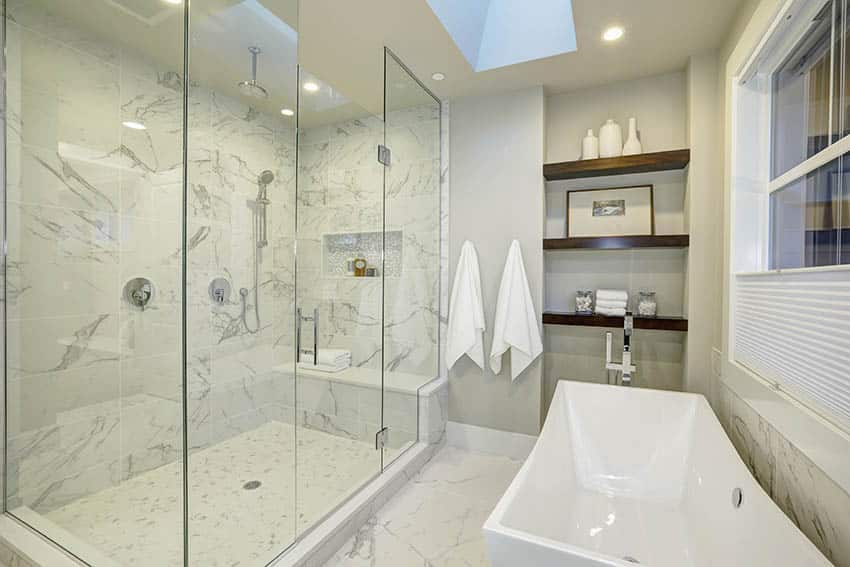 Bathroom with marble tile shower with bench rainfall head