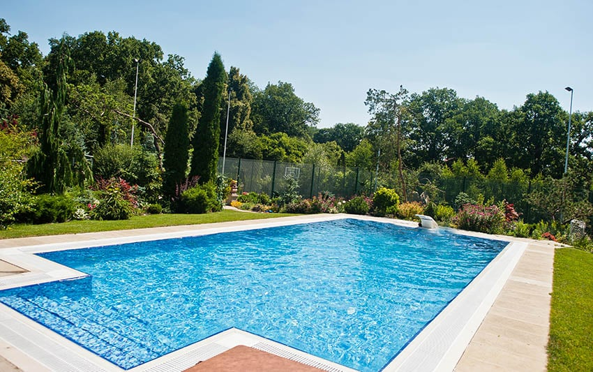 Beautiful blue chlorine swimming pool with rectangular design front entry steps