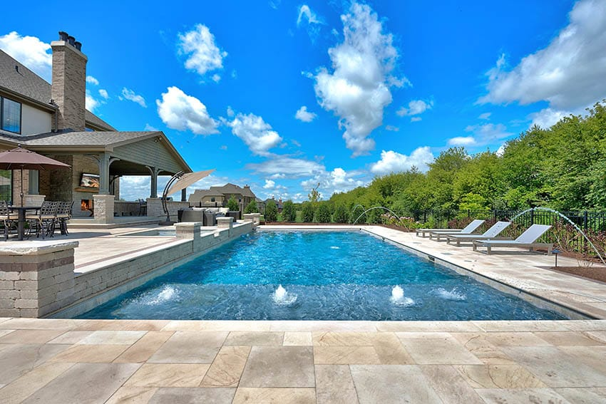 Beige marble pool deck with bubbler water features