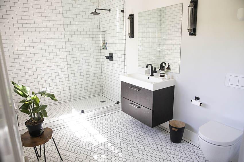 Ceramic subway tile walk in shower with floating vanity