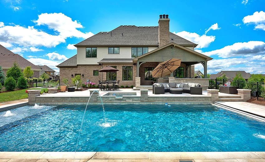 Chlorine swimming pool with water features raised pool deck with hot tub outdoor sitting area
