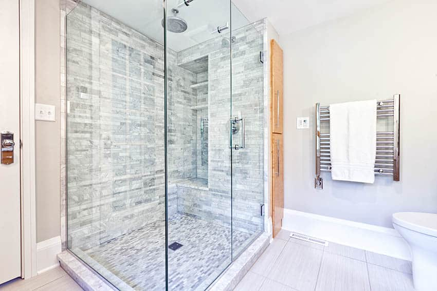 Contemporary bathroom shower with carrara marble tile rainfall head