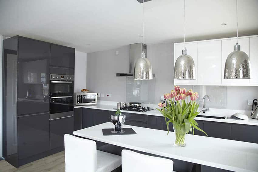 Contemporary kitchen dark gray high gloss cabinets white quartz cabinets silver pendant lights