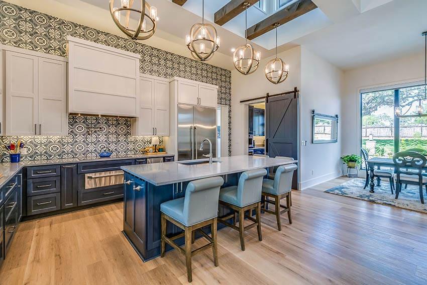 Contemporary kitchen with gray dekton countertops two tone cabinets white and blue island globe pendant lights