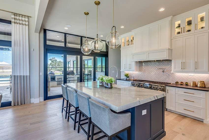 Contemporary kitchen with marble look Dekton countertops white shaker countertops