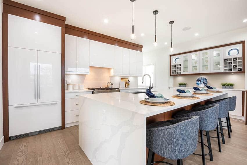 Contemporary kitchen with white lacquer cabinets calacatta quartz countertop pendant lights