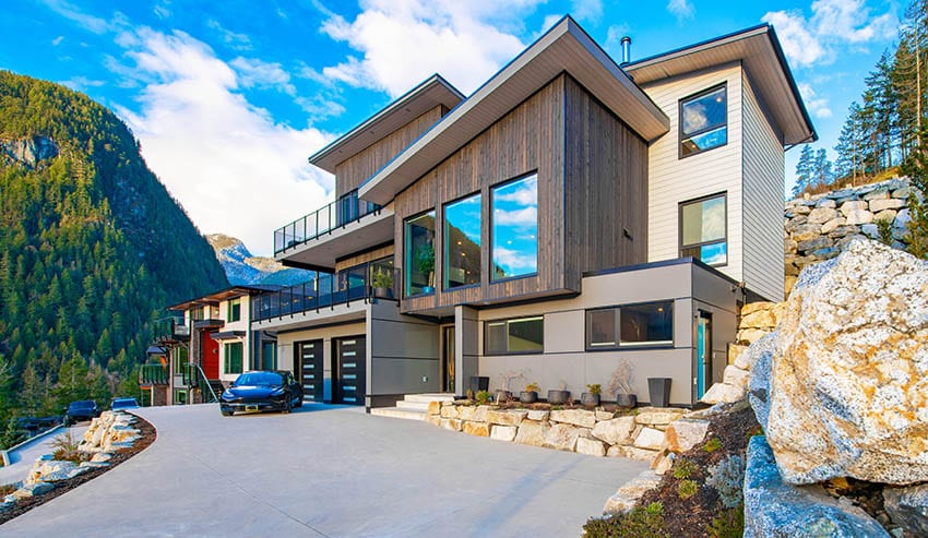Contemporary mountain house with tinted windows balcony views