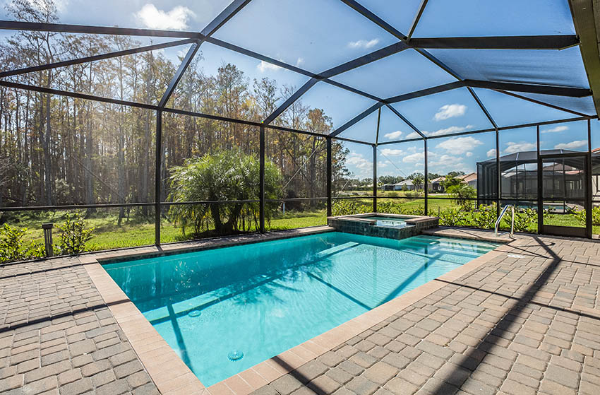 Covered chlorine swimming pool with paver deck
