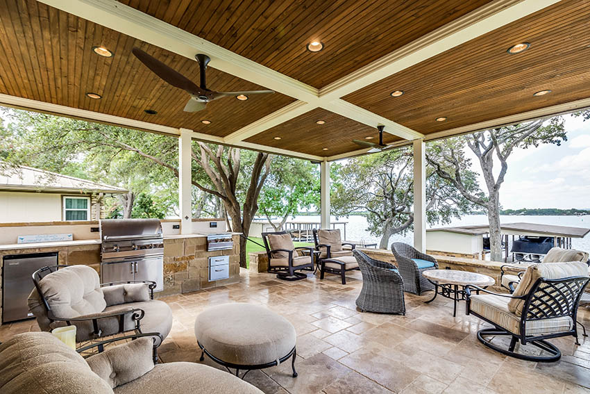 Covered patio with travertine pavers outdoor kitchen