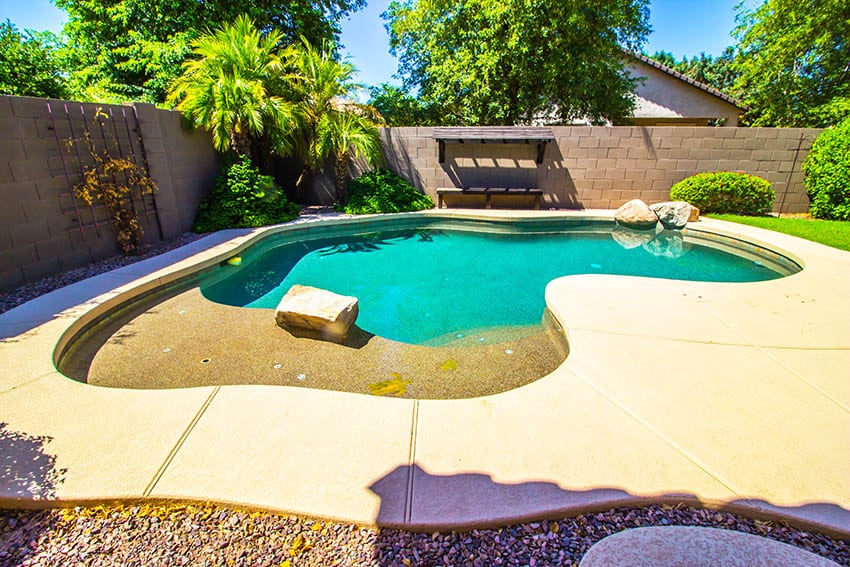Custom pool with thick concrete cantilever coping deck