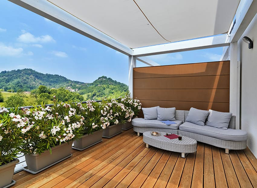 Deck with flower planters wind blockers canopy cover and privacy wall