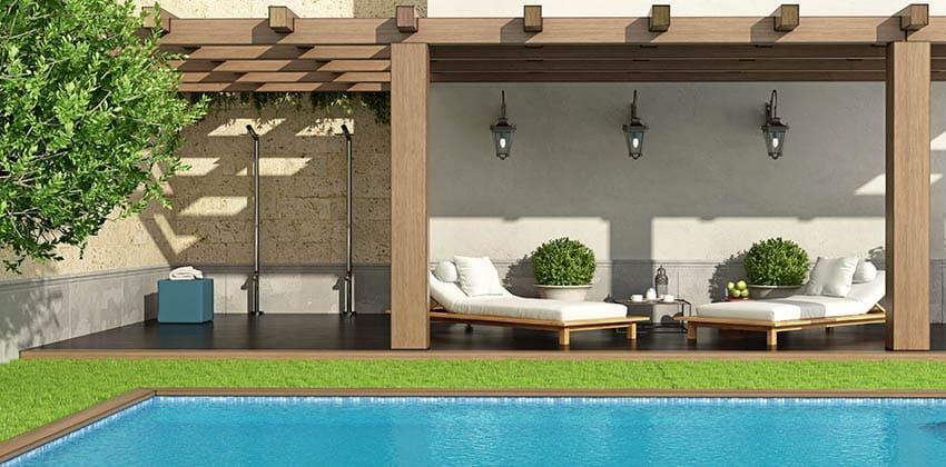 Fake grass around pool with long pergola sitting area