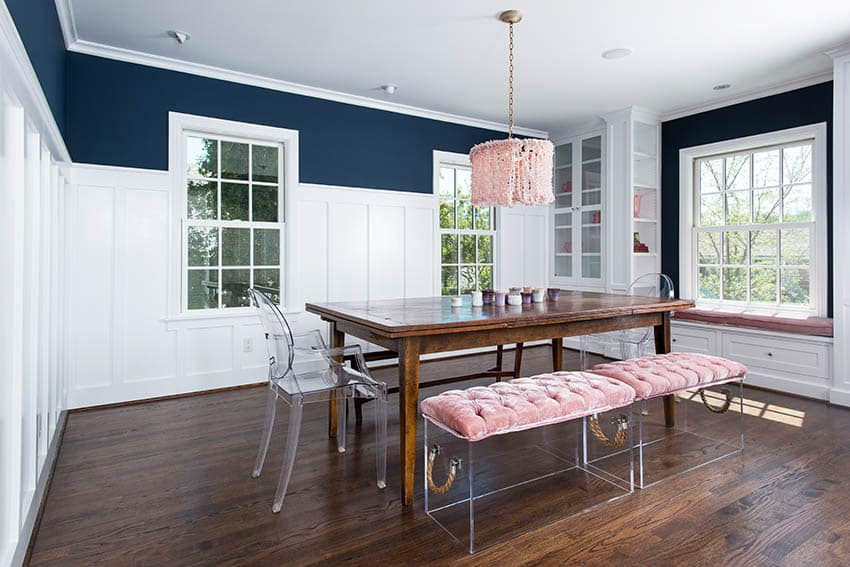 Glam dining room with board and batten wall paneling wood floor