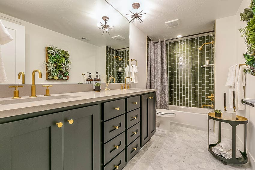 Guest bathroom with green vertical stacked glazed ceramic subway tiles and alcove tub