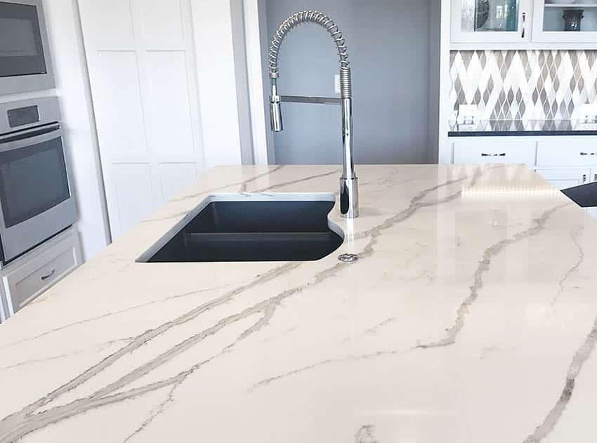 Kitchen island with silgranit sink callacatta quartz countertops