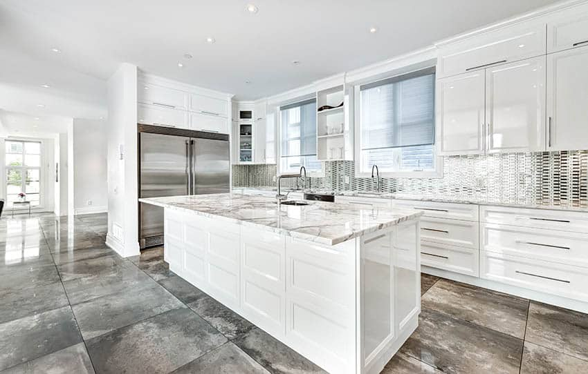 Kitchen with white painted high gloss cabinets quartz countertops polished concrete countertops