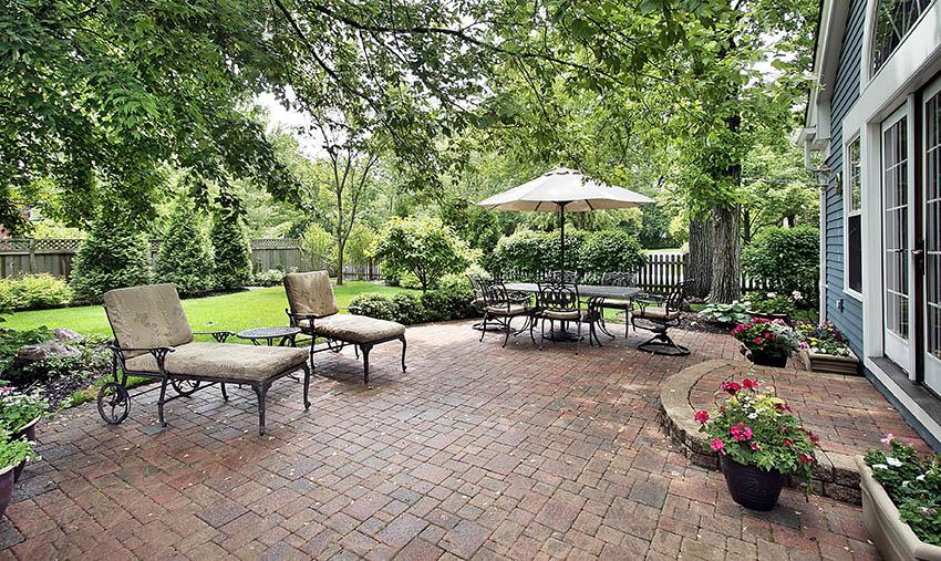 Large backyard paver patio with sealed coating application