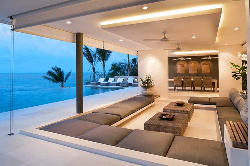 Luxury covered patio with roll down wind protection sunken outdoor living room