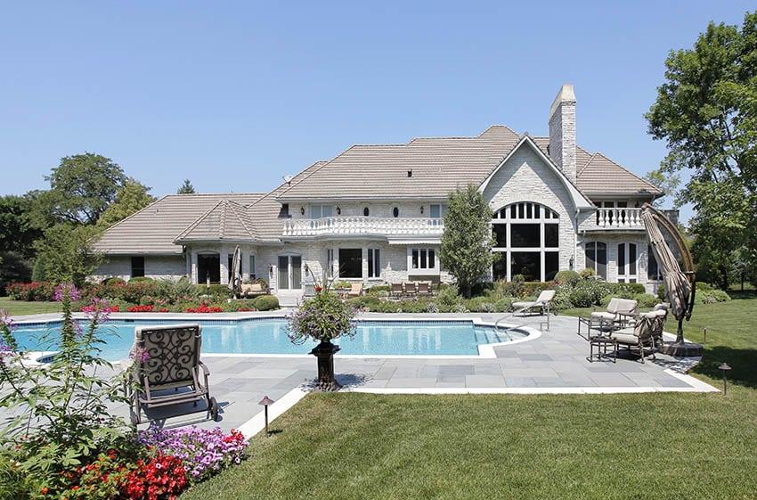 Marble pool deck in homes backyard
