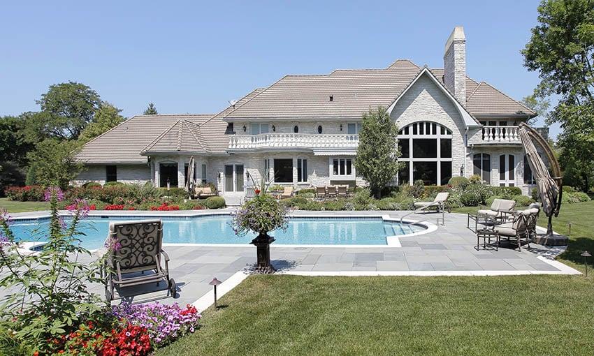 Marble pool deck pavers in homes backyard