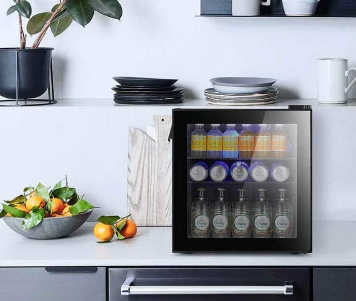 Mini beverage fridge with black glass