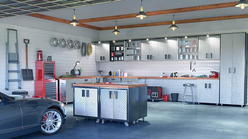 Minimalist garage with stainless storage cabinets workbench island