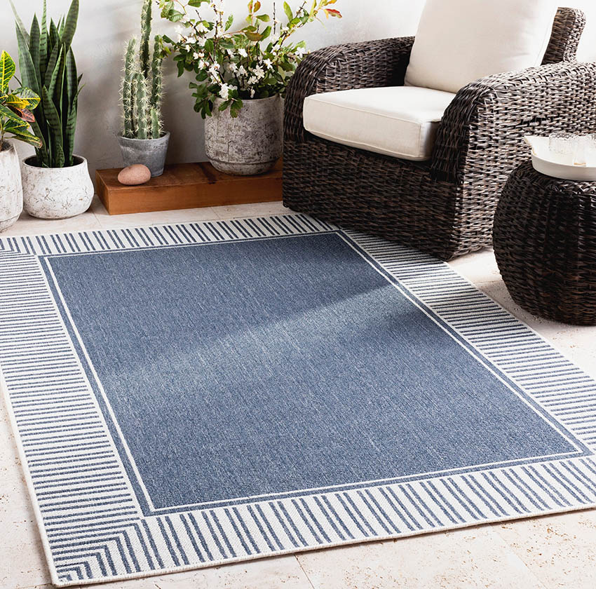 Modern blue white polyester rug on covered patio