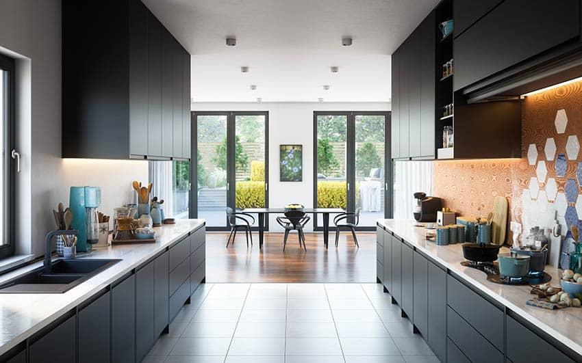 Modern galley kitchen with black silgranit sink black cabinets tile flooring