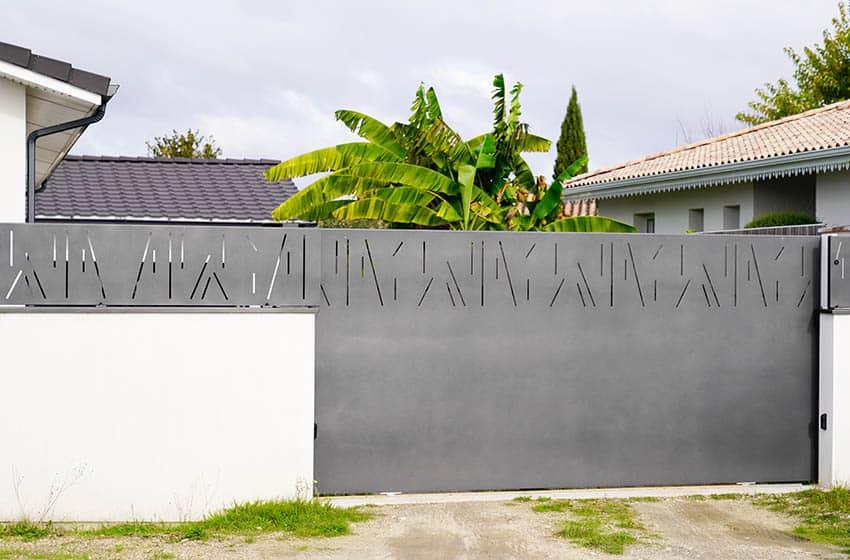 modern-gray-sliding-driveway-gate-with-privacy-slats