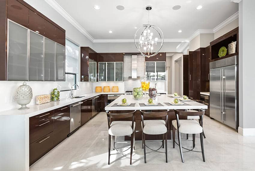 Modern kitchen with brown high gloss lacquer cabinets white quartz countertops center island and globe chandelier