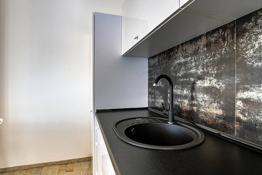 Modern kitchen with small round silgranit sink black pearl leathered granite countertops
