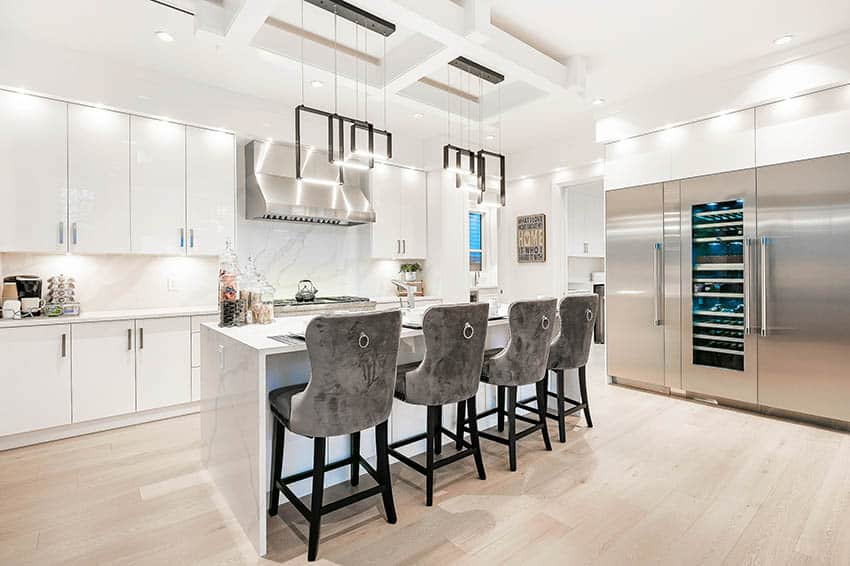 Modern white lacquer kitchen cabinets with silver hardware quartz waterfall island barrel back bar stools