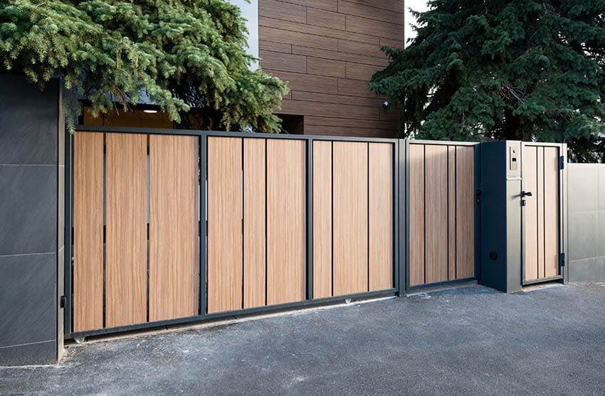 modern-wood-gate-with-powder-coated-metal-frame-and-side-door-entry-