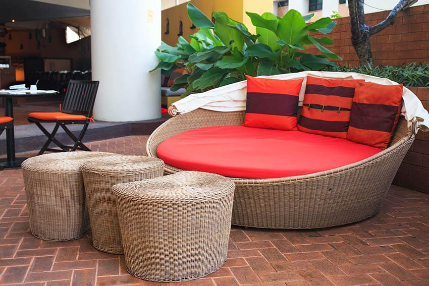 Sealed paver patio with wicker day bed wicker ottomans