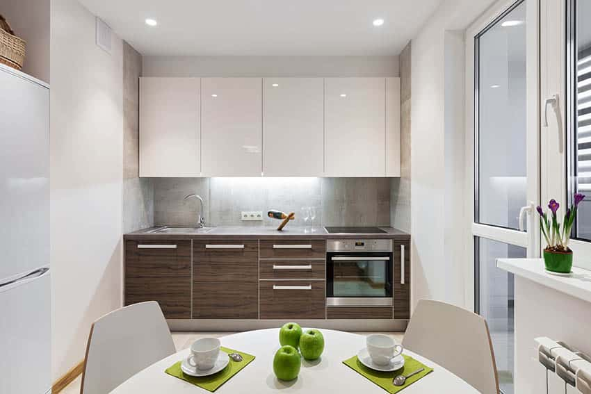 Small basement kitchen with high gloss white flat panel upper cabinets and veneer lower cabinets with gray quartz countertops