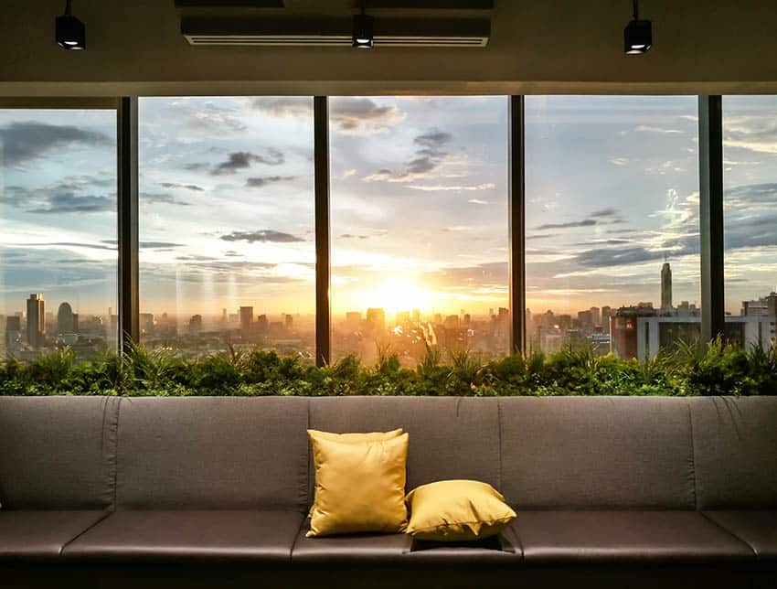 Tinted apartment house windows with city views sunset