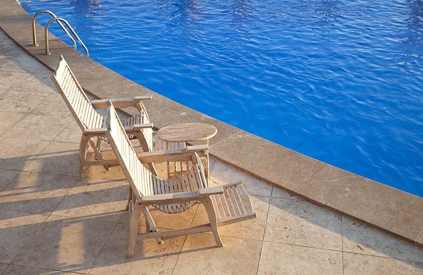Travertine pavers around swimming pool