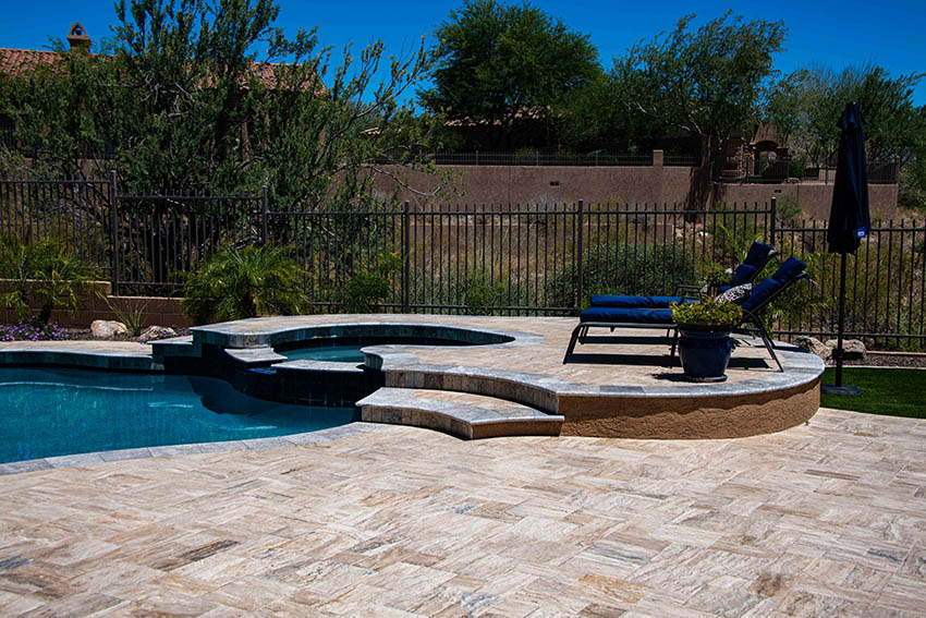 Travertine pool deck with elevated hot tub