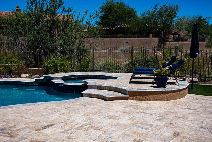 Travertine pool deck with raised sitting area