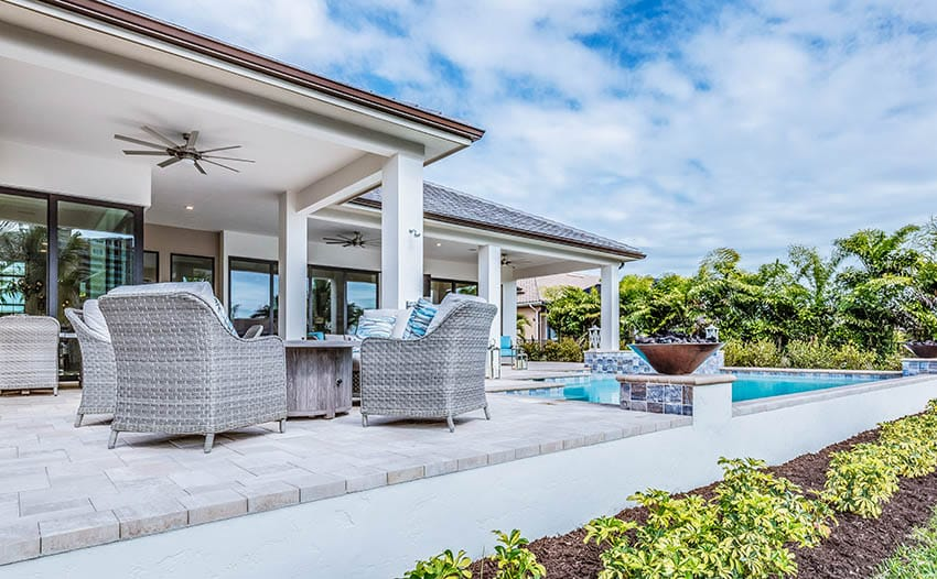 White marble pool deck pavers with raised patio