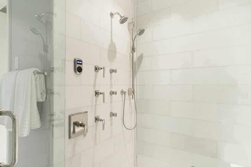 White matte porcelain tile shower with dual shower heads