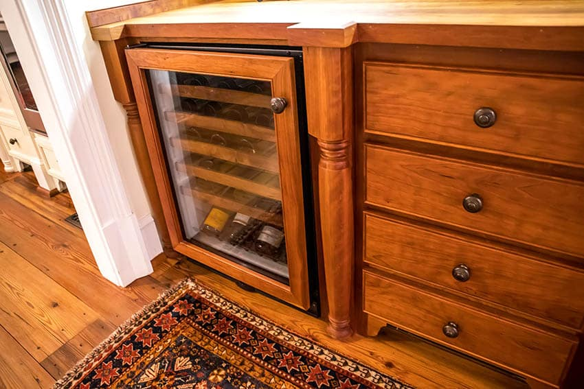 Wood home bar with wine bottle refrigerator