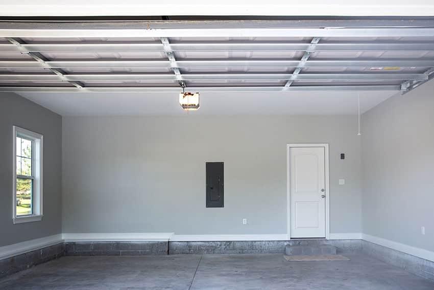 Garage with gray paint whtie door steel ceiling
