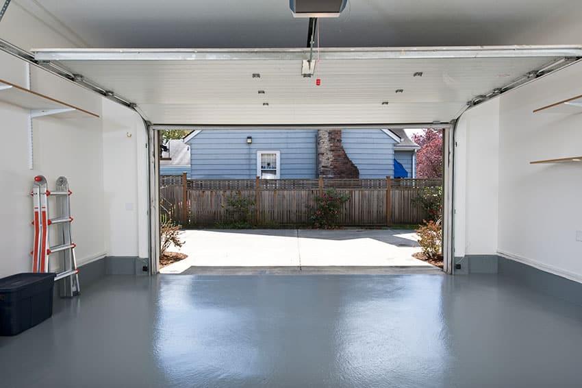 Interior garage with teal flooring light wall