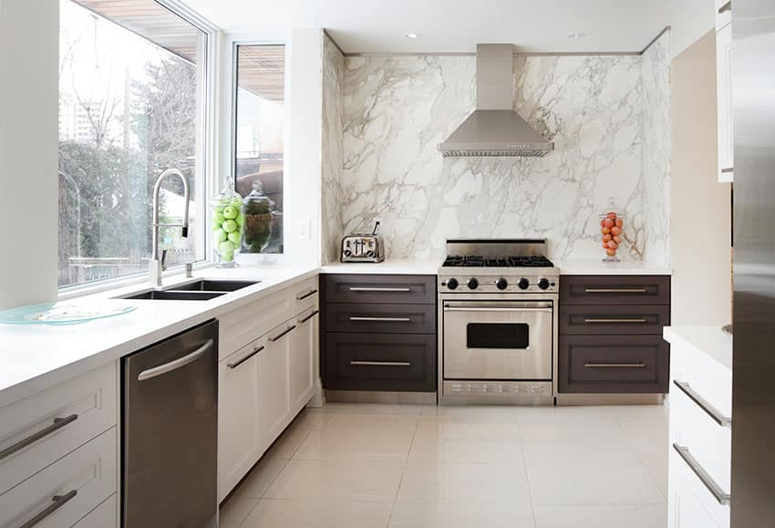 Kitchen with black and white cabinets glass window marble wall
