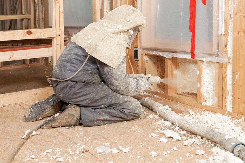 Man spraying foam insulation