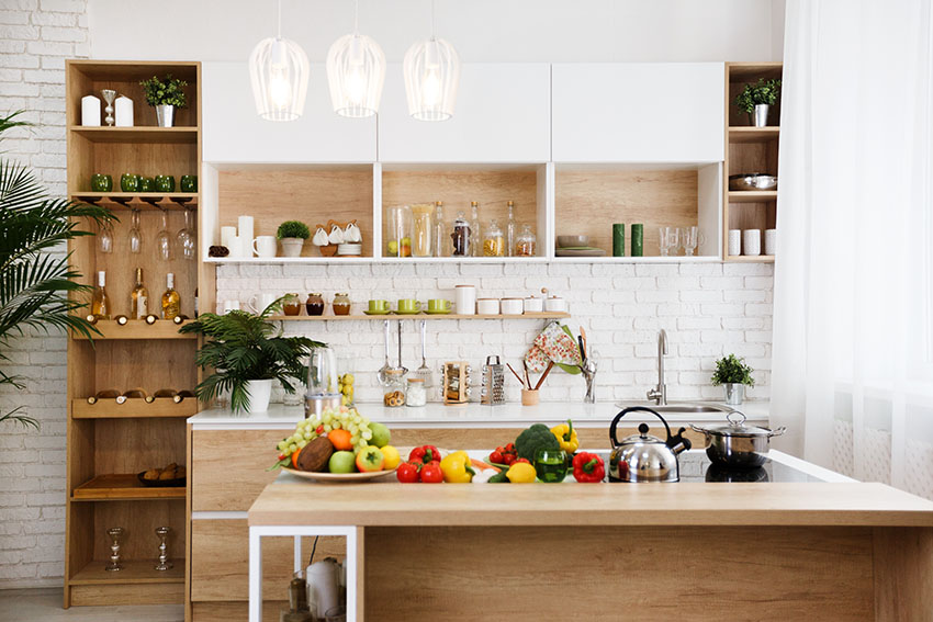 Rustic kitchen with small pantry wooden countertop white brick wall