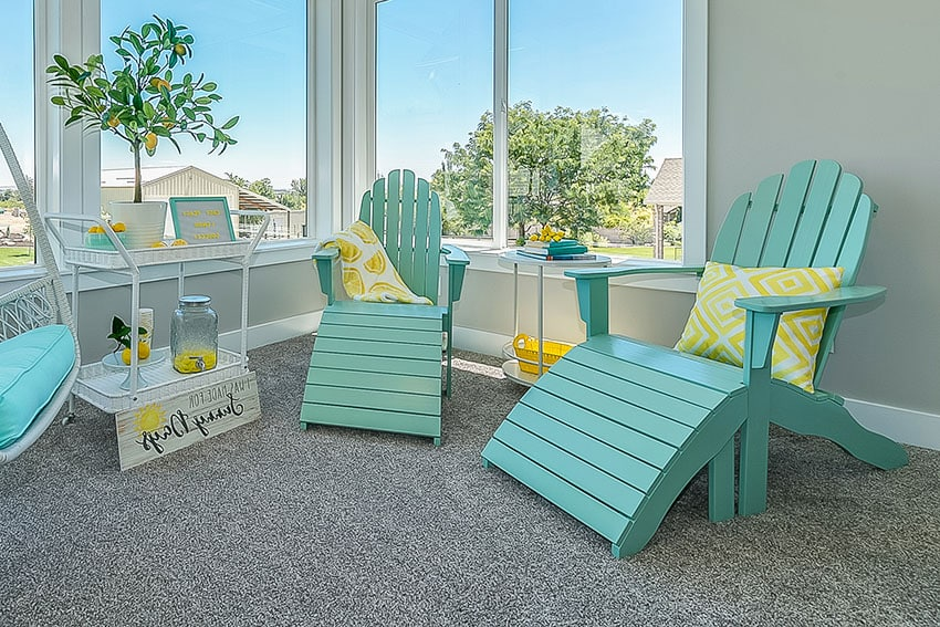 Sunroom with two polywood teal chair